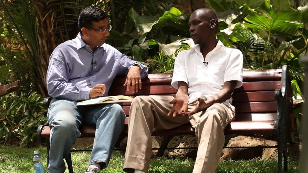Dinesh D'Souza, left, interviewing a subject for his film 2016: Obama's America.