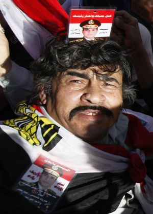 Protest: A supporter of General Abdel Fattah al-Sisi outside the presidential palace in Cairo after the bombings.