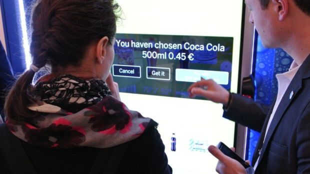 A demonstration of Coca-Cola's smart vending machines at the Mobile World Congress 2014 in Barcelona.