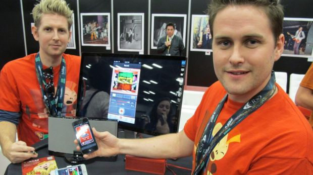 Joseph (L) and Sam Russell, brothers from Melbourne, Australia, show off their Jam smartphone app at the 2013 South by ...