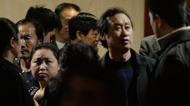 Frustrated by the changing story:  Chinese relatives of passengers from the missing Malaysia Airlines flight MH370 wait ...