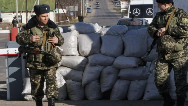 Ukrainian guards at a checkpoint at the border with Transnistria.