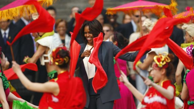 Stepping out: US first lady Michelle Obama dances with folk performers as she visits the Xi'an city wall.