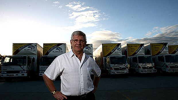 Mike O'Hagan with some of his truck fleet at his MiniMovers depot in Rocklea Brisbane.