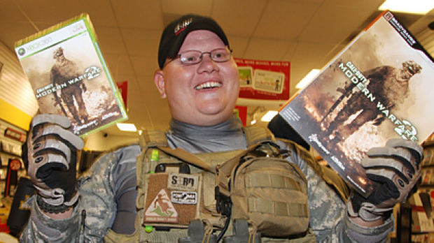 Erik Cota walks out of a shop in California shortly after <i>Call of Duty Modern Warfare 2</i> went on sale at midnight.