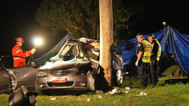 Crash ... a boy and girl died after the car they were in hit a power pole.