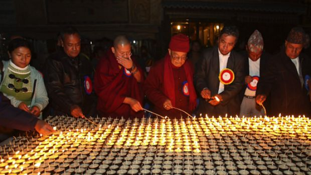 Representatives of various faiths light butter lamps in Kathmandu at a protest against the ritual slaughter of thousands ...