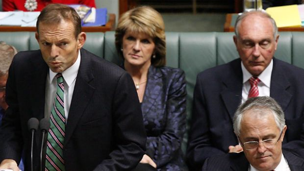 Winner ... Tony Abbott speaks in Parliament flanked by Malcolm Turnbull.