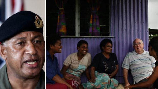 Powerful man... Frank Bainimarama, left, and father Kevin Barr sits with friends in the Muanivatu squatter settlement in ...
