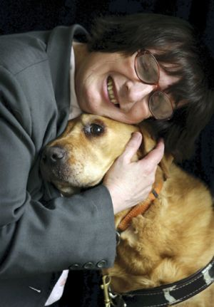 Michelle Stevens with her guide dog Oscar.