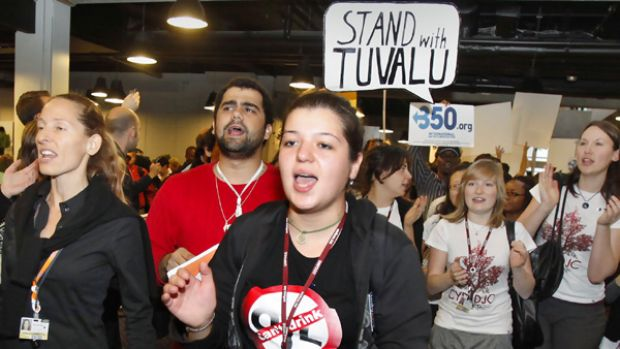 Activists hold a demonstration in support of the South Sea island of Tuvalu as delegates arrive for a meeting at the UN ...