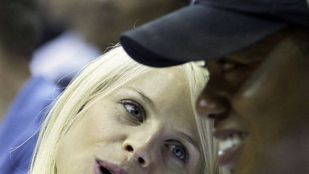 Working to save his family ... in this June 11, 2009, file photo, Elin Nordegren talks to her husband, Tiger Woods ...
