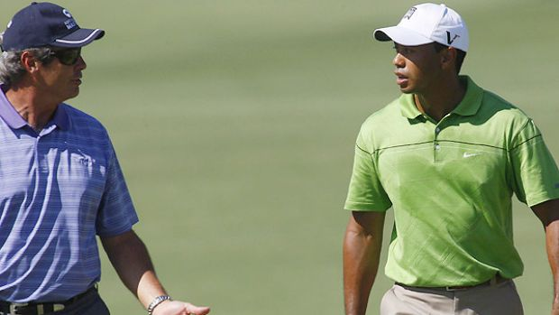 Ian Baker-Finch talks to Tiger Woods during the practice round at the Australian Masters last month.