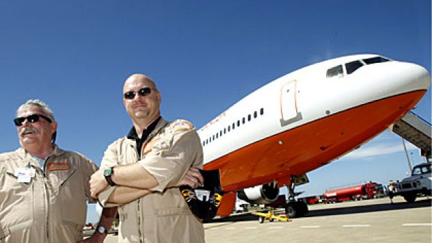 Pilots Captain Jack Maxey, left, and Captain Kevin Hopf in front of the DC-10 water bomber, Victoria's latest weapon in ...