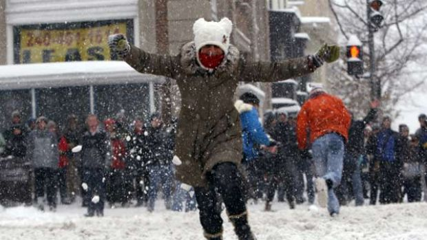 It's all good-natured fun until someone pulls a gun ... a woman runs away as she is hit by a snowball during the ...