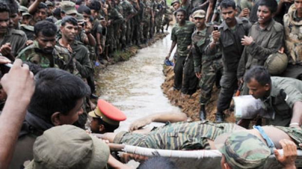 The body of the  Tamil Tigers leader Velupillai Prabhakaran (above), children in a refugee camp (bottom left) and ...