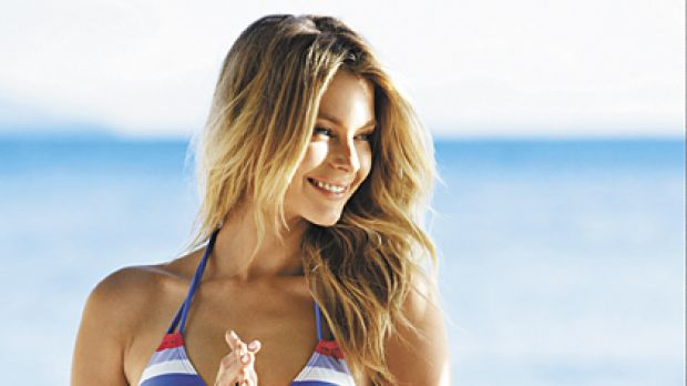 'I'm not a stick figure' .. Jennifer Hawkins has posed nude, un-airbrushed, on the cover of Marie Claire magazine.