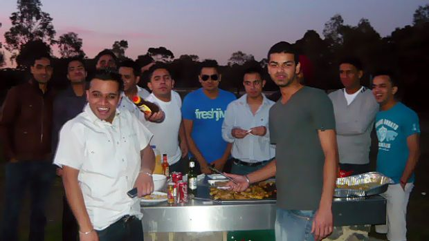 Mr Garg, front left, celebrating his birthday with friends last year.