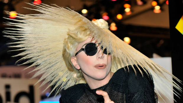 Singer Lady Gaga gestures during an announcement of her long term partnership with Polaroid as the brand's creative ...