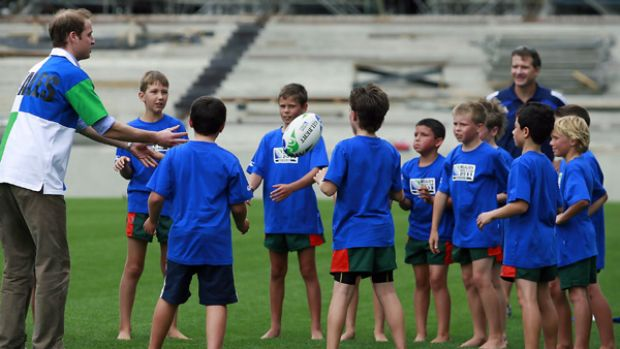 Prince William plays with children at Eden Park during a visit ahead of the 2011 Rugby World Cup in Auckland, New Zealand.