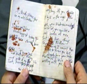 The blood-stained notebook Woolley used to scrawl messages to his family.