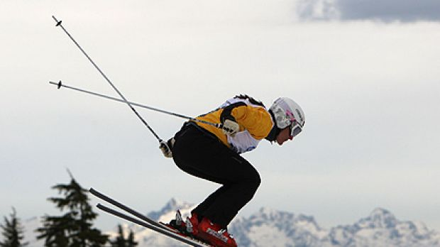 Flying  ... Jenny Owens takes to the air during a ski cross qualification event  near Vancouver last year; inset, the ...