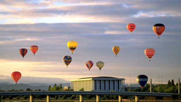 Canberra's masterpieces ... ballooning at dawn over the city.