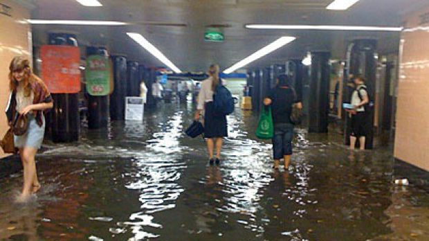 Water floods the Degraves Street Subway in Melbourne this afternoon.