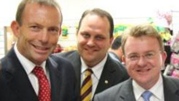 In the wings to offer a hand ... Scott Driscoll, centre, with Tony Abbott, left, and Bruce Billson, right.