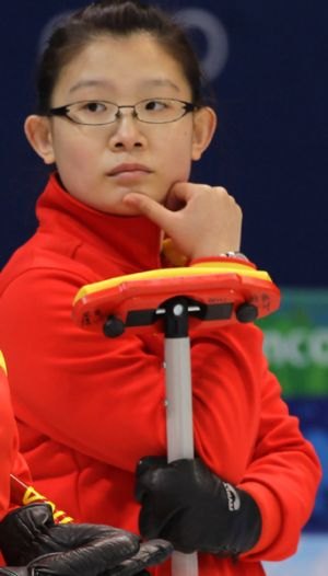 "China's ""Betty"" Bingyu Wang discusses strategy in a match against Great Britain during round robin session of the ..."