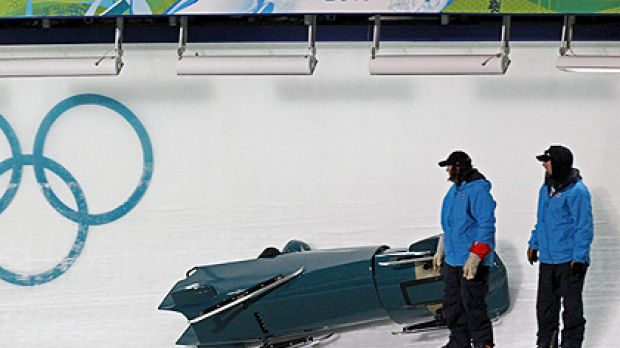 The Australian bobsleigh team of Duncan Harvey and Christopher Spring crashes during training run at Whistler.