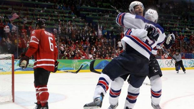 American dream ... Zach Parise and Ryan Kesler of the United States embrace after Kesler scored the final goal of the ...