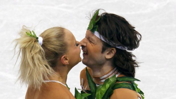 Russia's Oksana Domnina and Maxim Shabalin rub noses at the end of their performance in the ice dance original dance ...
