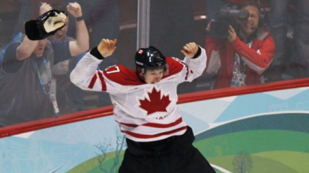 Happy Sidney ... Canada's Sidney Crosby celebrates his game winning goal during overtime period men's ice hockey gold ...