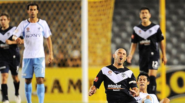 Kevin Muscat is sent crashing to the turf.
