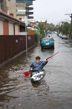 Matthieu Filippini paddling in the flooded streets of Richmond.