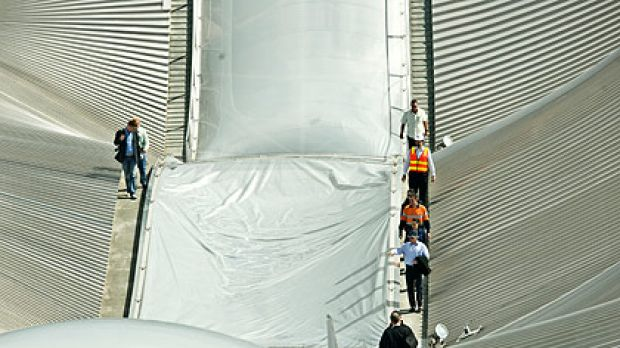 Inspecting storm damage to Southern Cross Station's roof yesterday.