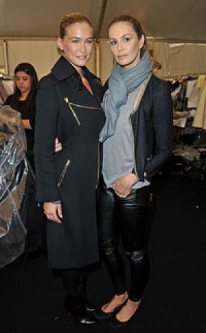 Bar Refaeli and Elle Macpherson pose backstage before the Louis Vuitton show at Paris Fashion Week.