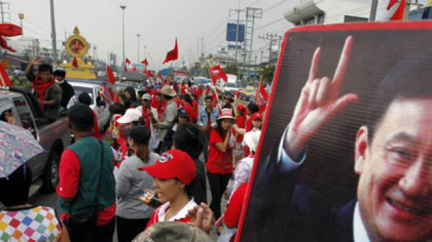 Gathering storm ... supporters of  former Thai premier Thaksin Shinawatra on a highway in Bangkok.