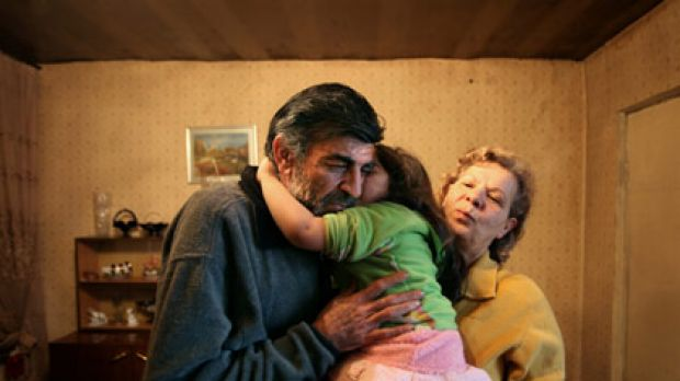 Multiple drug resistant TB sufferer Vazgen Hakobyan, 57, with wife Anahit and granddaughter Christine, at home in ...