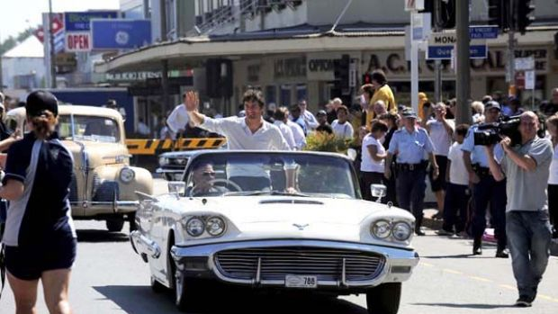Home-town hero Mark Webber parades along the main street of Queanbeyan... without any mechanical problems.