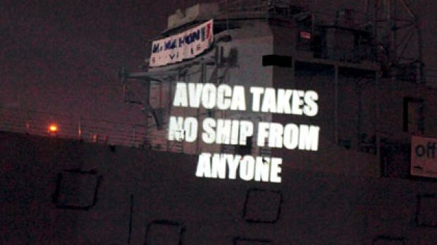 Projecting their anger ...  protesters make a point on the old warship.