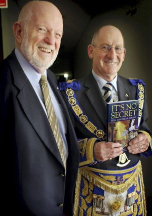 Freemason author Peter Lazar, and Grand Master of the United Grand Lodge, Garry Sebo, with Lazar's book It's No Secret - ...