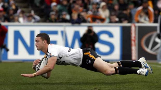 Talent to burn ... Tim Moltzen of the Wests Tigers slotted into halfback with ease last round after starting at fullback ...