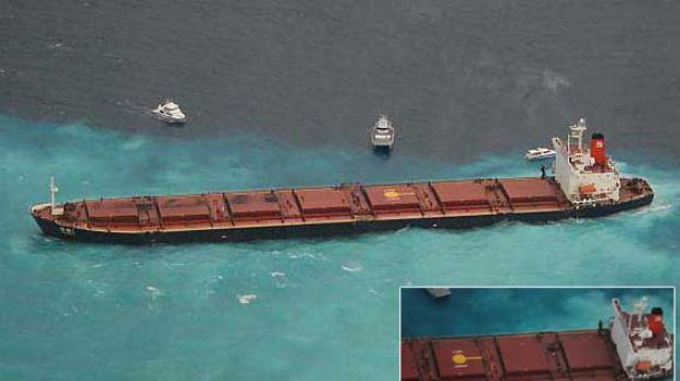 The Chinese-registered bulk coal carrier Shen Neng 1 aground 70 kilometres east of Great Keppel Island. INSET: A ...