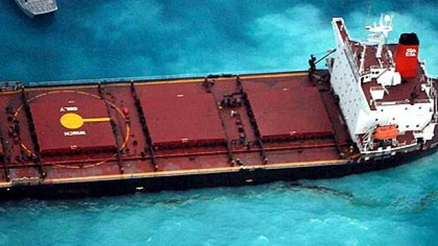 The Chinese coal ship Shen Neng 1 lies stranded and leaking oil on Douglas Shoals in the Great Barrier Reef after ...