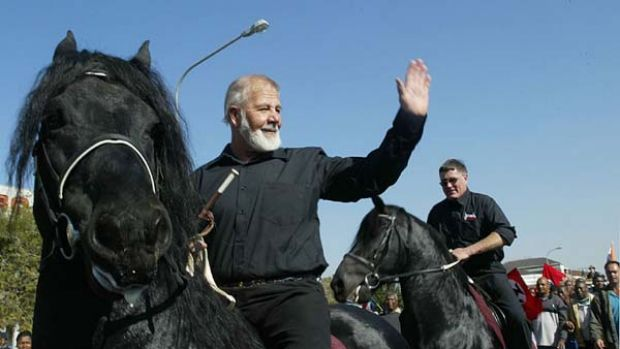 South African white supremacist Eugene Terre'Blanche  rides a black horse after being released from prison in ...