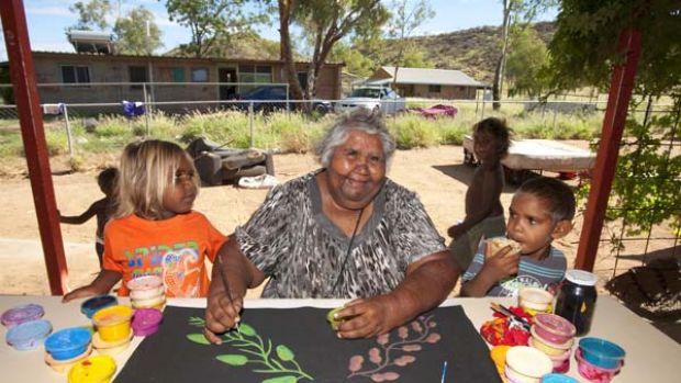 Aboriginal artist Jane Young at Hidden Valley town camp with her grandsons.