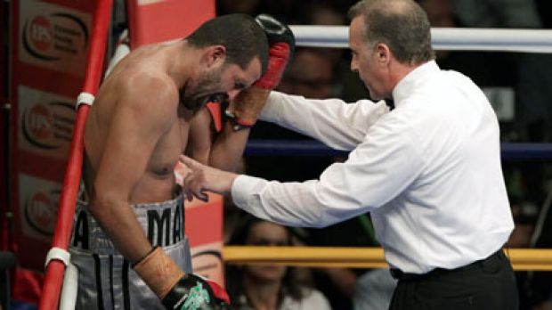 Manny Siaca complains after a clash of heads with Danny Green.