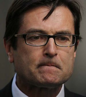 Assistant Minister for Climate Change, Greg Combet, announces the dumping of the home insulation scheme today.